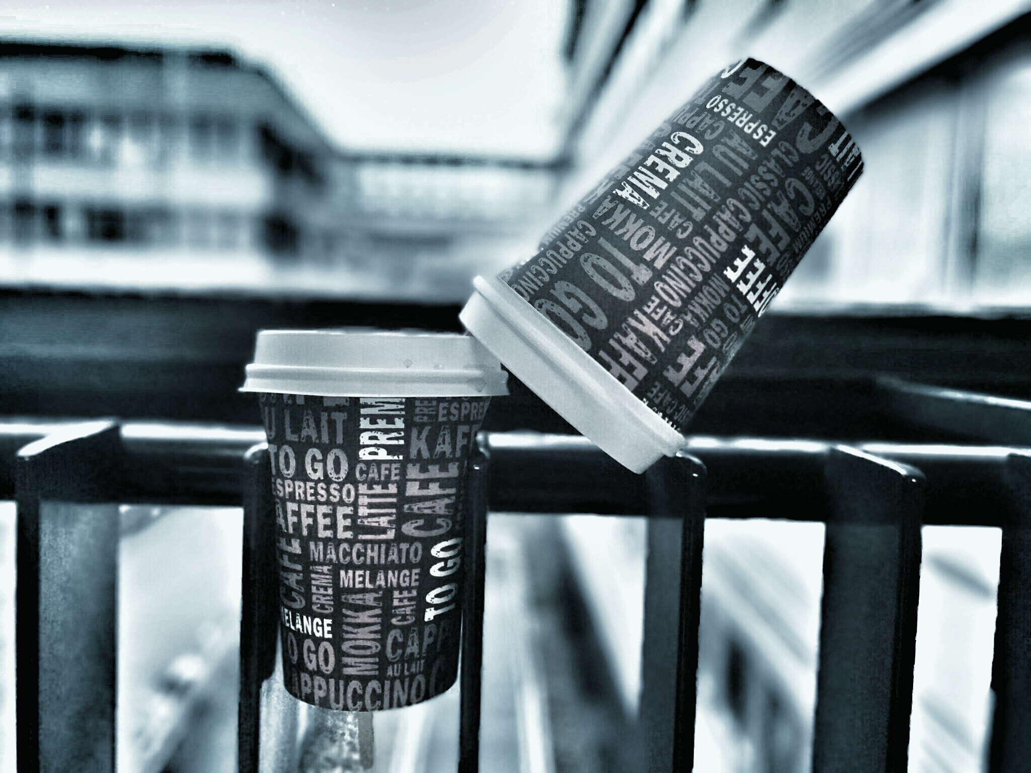 Image of two paper coffee mugs. One of them represents a summit and the other one appears to be climbing in a crevasse, trying to get up.